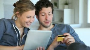 stock-footage-young-couple-at-home-buying-on-internet1